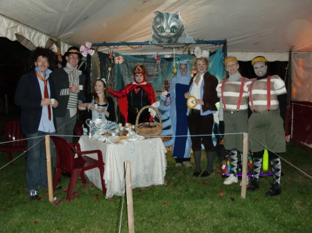 Red Cross Volunteers dressed up like the characters of Alice in Wonderland... notice the Cheshire Cat at the top!